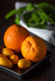 Oranges with tangerins in close-up Royalty Free Stock Image