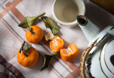 Oranges with tea pot and cup. Royalty Free Stock Images