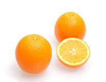 Oranges. Three oranges fruit on white background Royalty Free Stock Images