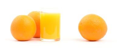 Oranges. Three oranges and a glass of orange juice isolated on white Stock Photo