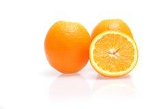 Oranges. Three oranges on white table Royalty Free Stock Photo
