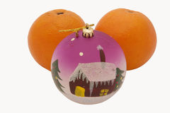 Oranges with a toy. On the white background royalty free stock photography