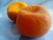 Oranges. Two oranges on floor Stock Photography