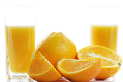 Oranges and two glasses of juice Stock Photo