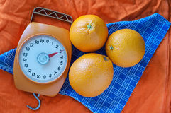 Oranges. Two oranges on an orange cloth Stock Photography
