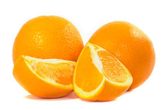 Oranges. Two oranges and two slices of orange on a white background Royalty Free Stock Photography