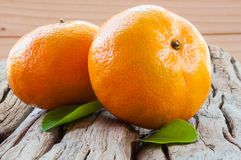 Oranges. Two oranges on wooden background stock photography