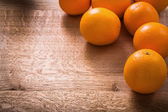 Oranges on vintage wooden board with organized Stock Photo