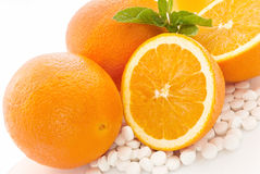 Oranges and vitamin c pills Stock Images