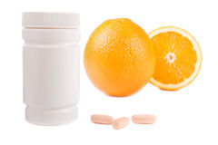 Oranges, vitamin pills and container isolated Stock Photography