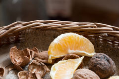 Oranges and walnuts in a basket Stock Photos
