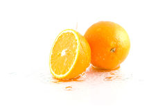 Oranges and water Royalty Free Stock Photos