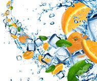 Oranges in water splash Royalty Free Stock Image