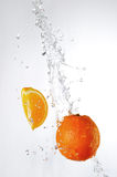 Oranges and water splash Stock Images
