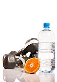 Oranges, weights and botte of water. Isolate on white background Stock Photo