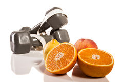 Oranges, weights and botte of water. Isolate on white background Stock Photos