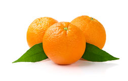 Oranges on White Background. Three Oranges with Leaves Isolated on White Background Royalty Free Stock Photography