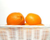 Oranges in white basket stock images