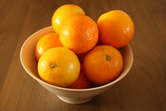 Oranges in a white bowl Stock Photography