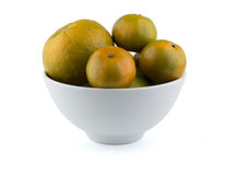Oranges in white bowl Stock Photo