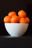 Oranges in a white bowl Royalty Free Stock Photography