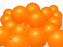 Oranges on a white plane. Oranges piled in a heap on a white background Stock Photography