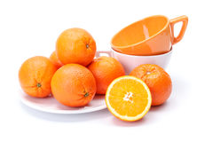 Oranges on white plate Royalty Free Stock Photo