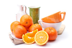Oranges on white plate Royalty Free Stock Photos