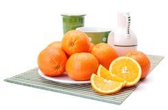 Oranges on white plate Royalty Free Stock Photos