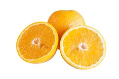 Oranges. Are whole and cut on a white background royalty free stock image
