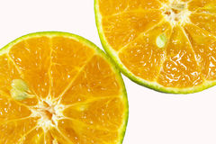 Oranges. Whole orange half an orange orange slice in the peel on the green leaves on a white background royalty free stock image