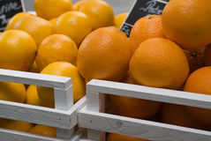 Oranges in wood box at shop. Oranges in twin wood box at shop Royalty Free Stock Photos