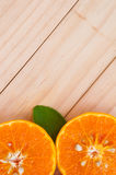 Oranges on wood texture background Stock Photos