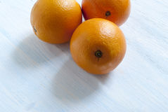 Oranges on wooden background. Oranges lie on the old wooden background Stock Photo