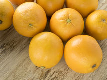 Oranges on wooden background. Oranges lie on the old wooden background Royalty Free Stock Photos