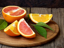 Oranges on a wooden background. Oranges orange and red on a wooden background royalty free stock photography