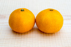 Oranges on wooden base Stock Photography
