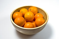 Oranges in wooden basket Royalty Free Stock Images