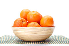 Oranges in wooden bowl Stock Photo