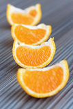 Oranges on a wooden table Stock Photography