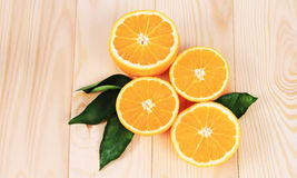 Oranges  on the wooden table. Oranges cut in half on the wooden table Stock Photography