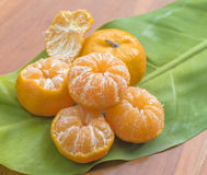 Oranges. On a wooden table on a green background Stock Images