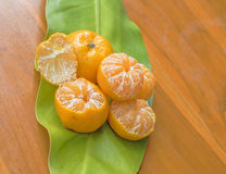 Oranges on a wooden table. On a green background Royalty Free Stock Photography