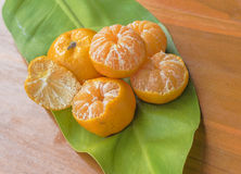 Oranges on a wooden table. On a green background Royalty Free Stock Photos
