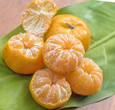 Oranges on a wooden table Stock Photos
