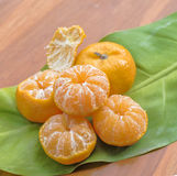 Oranges on a wooden table Stock Images
