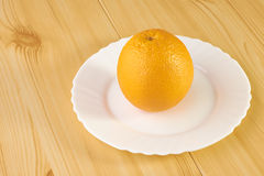 Oranges on wooden table Stock Photos