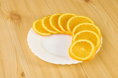 Oranges on wooden table Royalty Free Stock Images