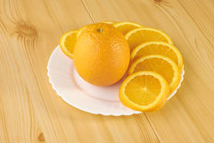 Oranges on wooden table Royalty Free Stock Photo