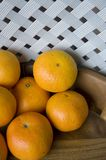 Oranges in wooden tray Stock Photos